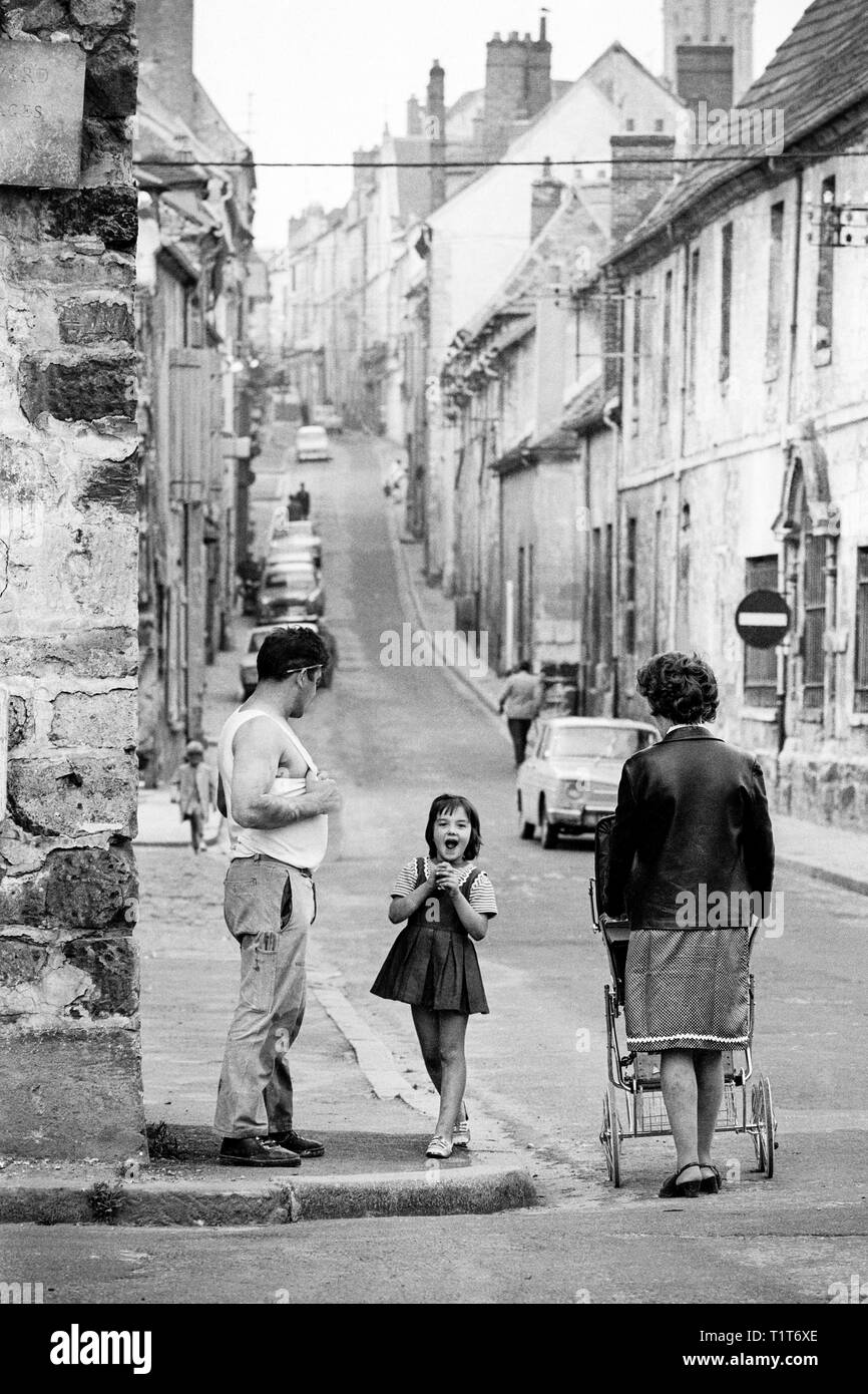 A moment of joy and excitement for a little girl in the main street of the town of Senlis, near Paris, France, in 1968 - Stock Image