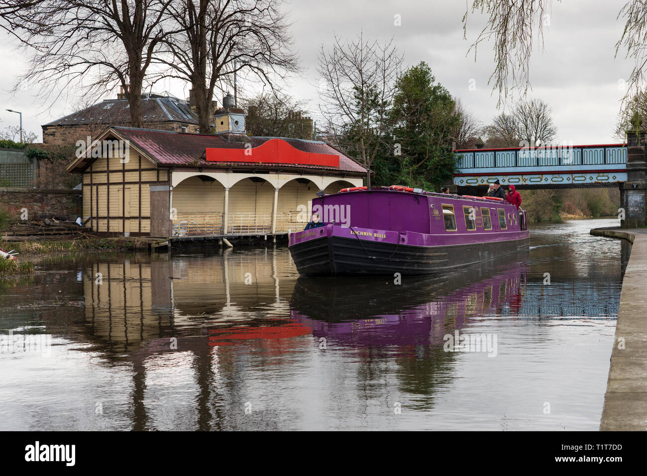 The Union Canal with narrowboat and Edinburgh Canal Society boathouse in early spring  in Edinburgh, Scotland, UK - Stock Image