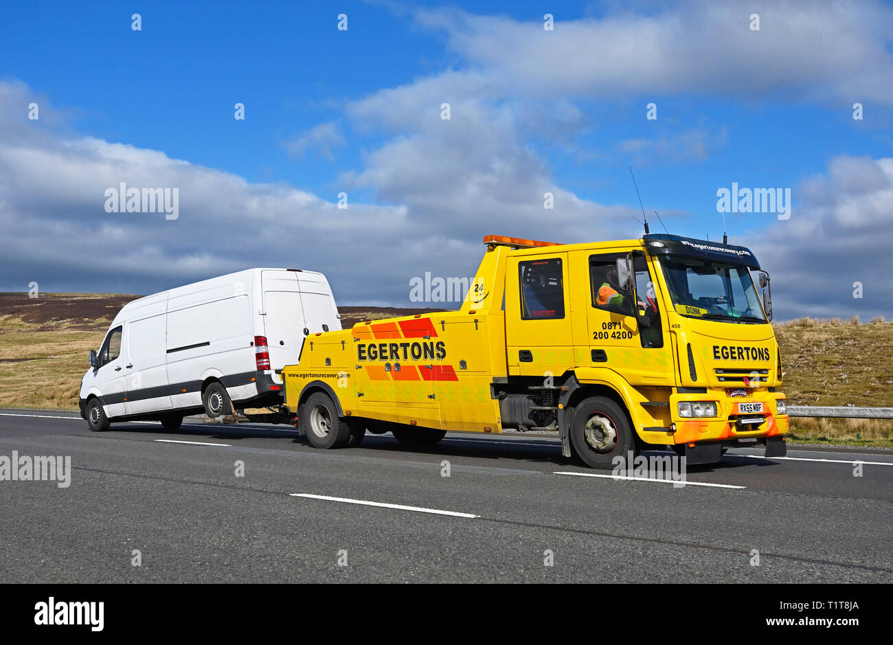 Edgertons Recovery HGV with White Van. M6 Motorway, Southbound, Shap, Cumbria, England, United Kingdom, Europe. Stock Photo