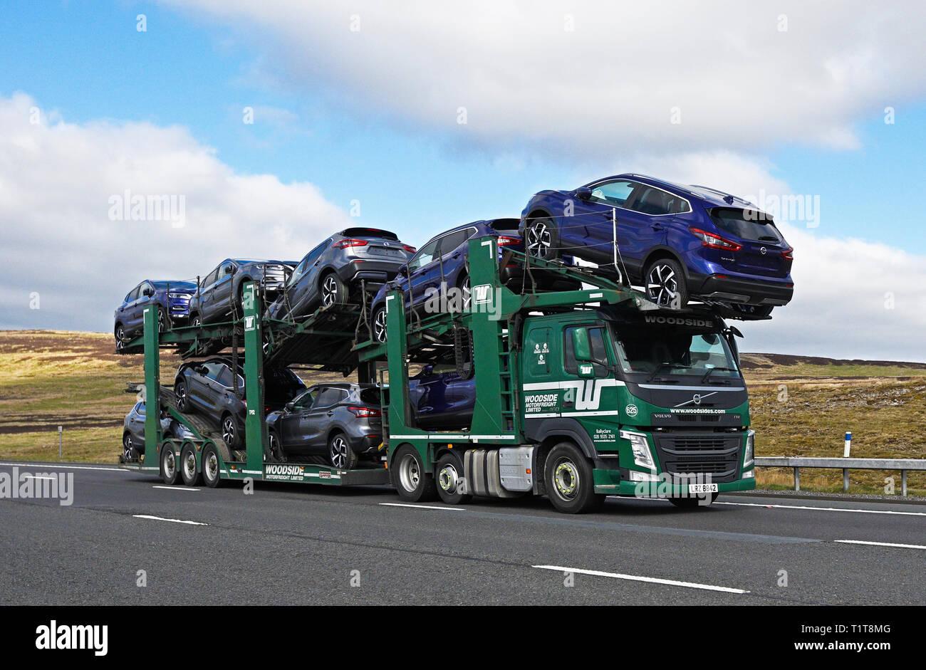 Woodside Motorfreight Limited car transporter HGV. M6 Motorway, Southbound, Shap, Cumbria, England, United Kingdom, Europe. - Stock Image