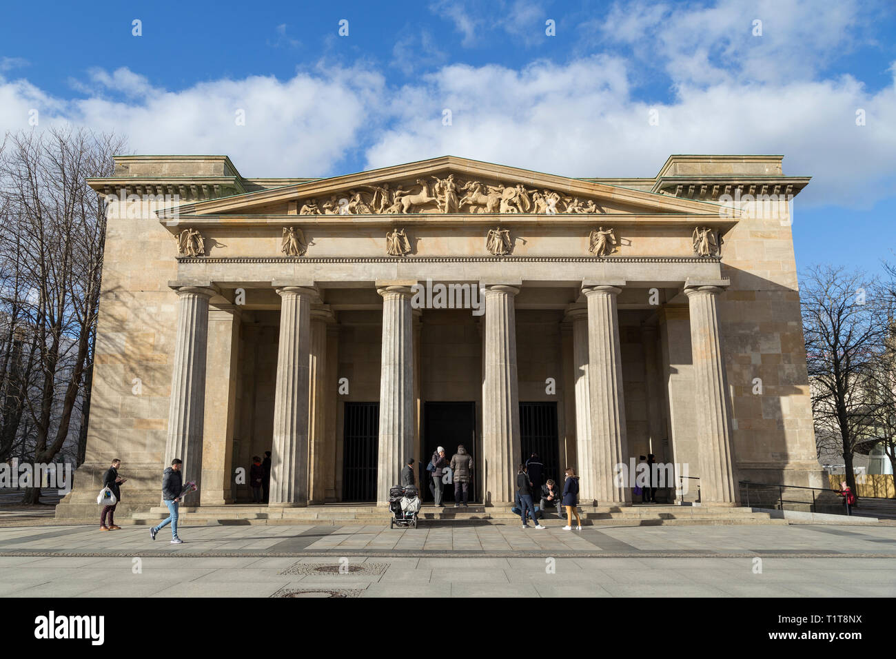 People at the Neo-Classical Neue Wache, war memorial for the victims of war and dictatorship in Berlin, Germany, on a sunny day. Stock Photo
