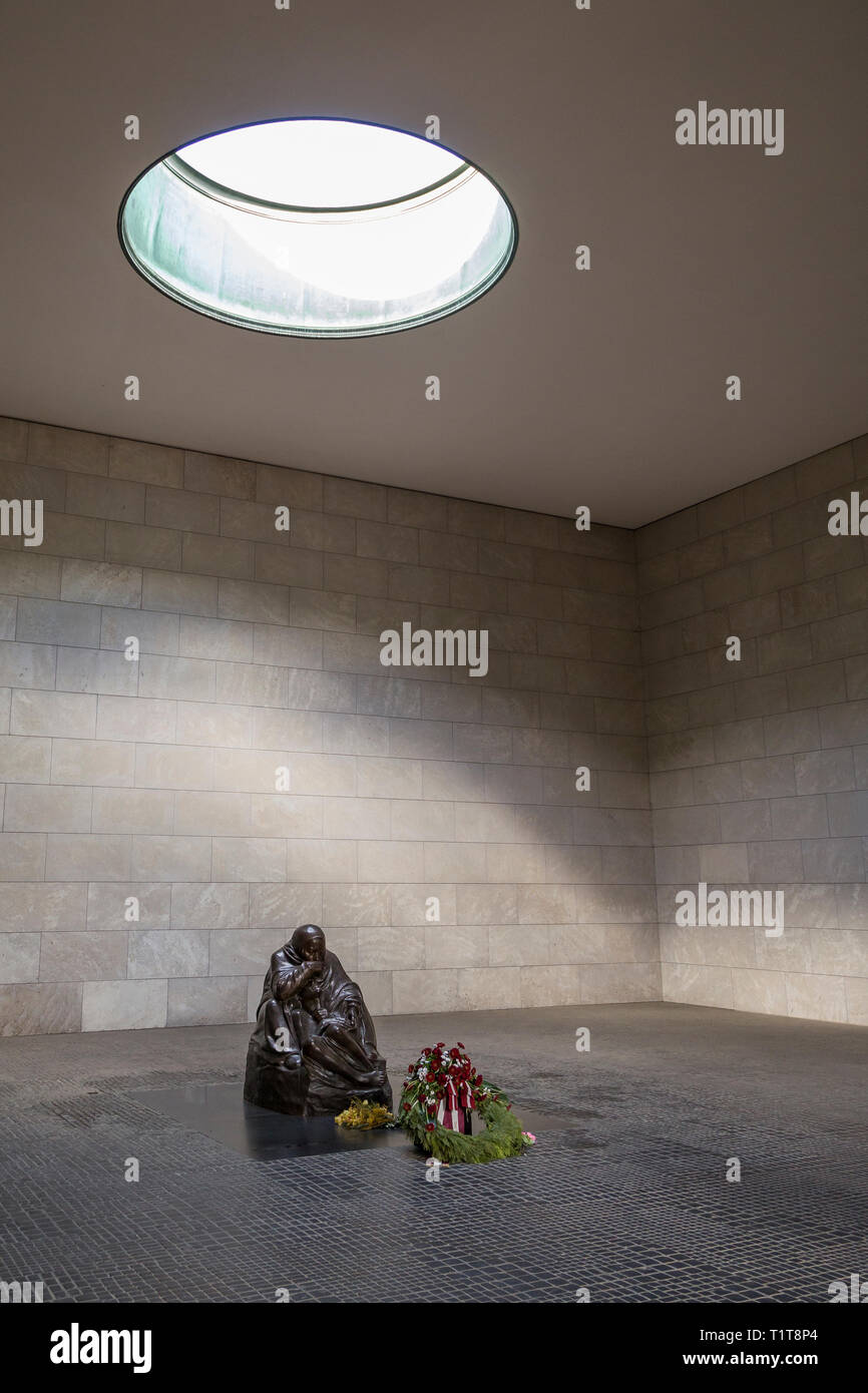 """Sculpture """"Mother with head Dead Son"""" by Käthe Kollwitz inside the Neue Wache. It servers as a war memorial for the victims of war and dictatorship. Stock Photo"""