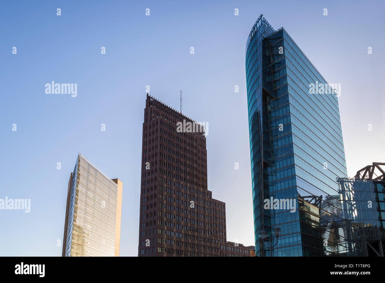 Modern high-rise buildings against clear blue sky at Potsdamer Platz in downtown Berlin, Germany, on a sunny day. Stock Photo
