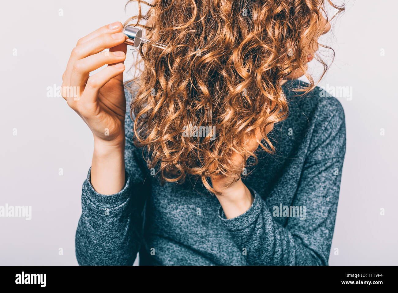 Young Woman Holding Pipette With Nutritional Oil Applying On Her Thick Curly Hair Female S Hands Using Cosmetic Serum To Prevent Split Ends Stock Photo Alamy