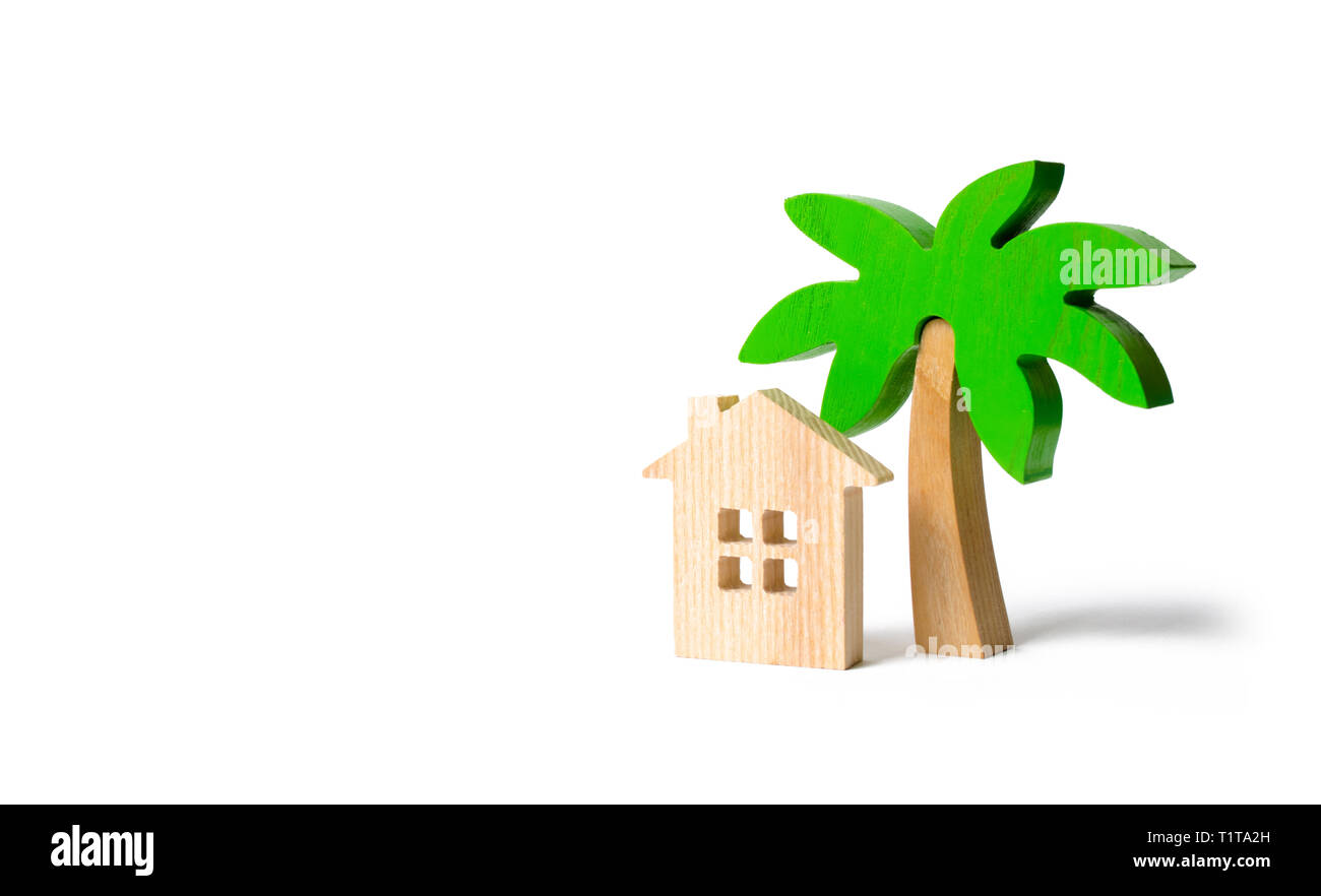 Wooden palm tree and hut on an isolated background. Conceptual leisure and vacation. Rental homes and properties in the resort. Romantic travel. Enter Stock Photo