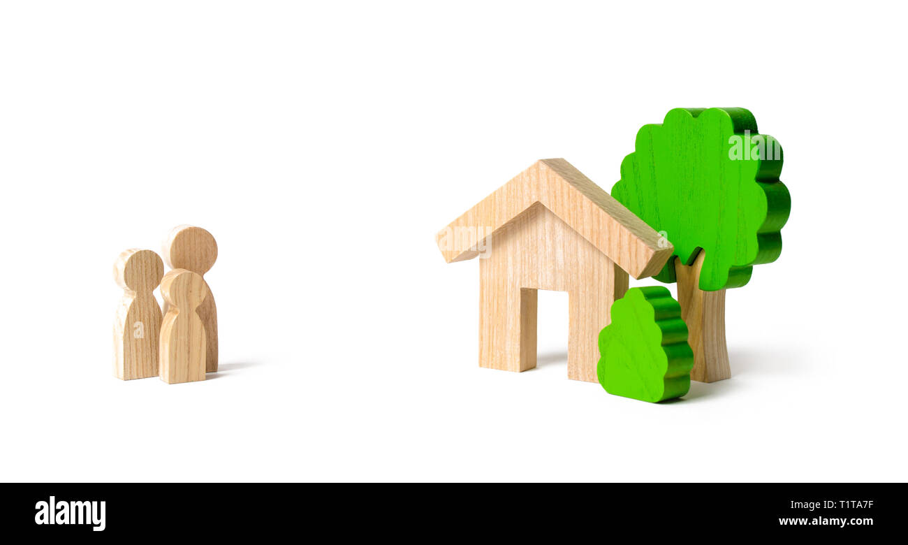 Figures of the family and house on an isolated background. real estate, your own home. Affordable housing on credit or mortgage. Renovation and constr - Stock Image