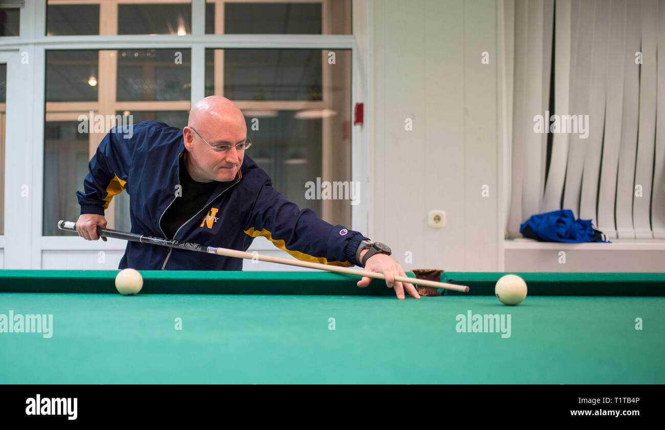 March 19, 2015 - Baikonur, Kazakhstan - Expedition 43 NASA Astronaut SCOTT KELLY plays pool with Russian Cosmonaut Mikhail Kornienko of the Russian Fe - Stock Image