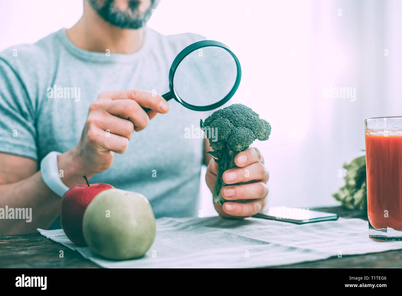 Motivated interested man learning different types of vegetables - Stock Image