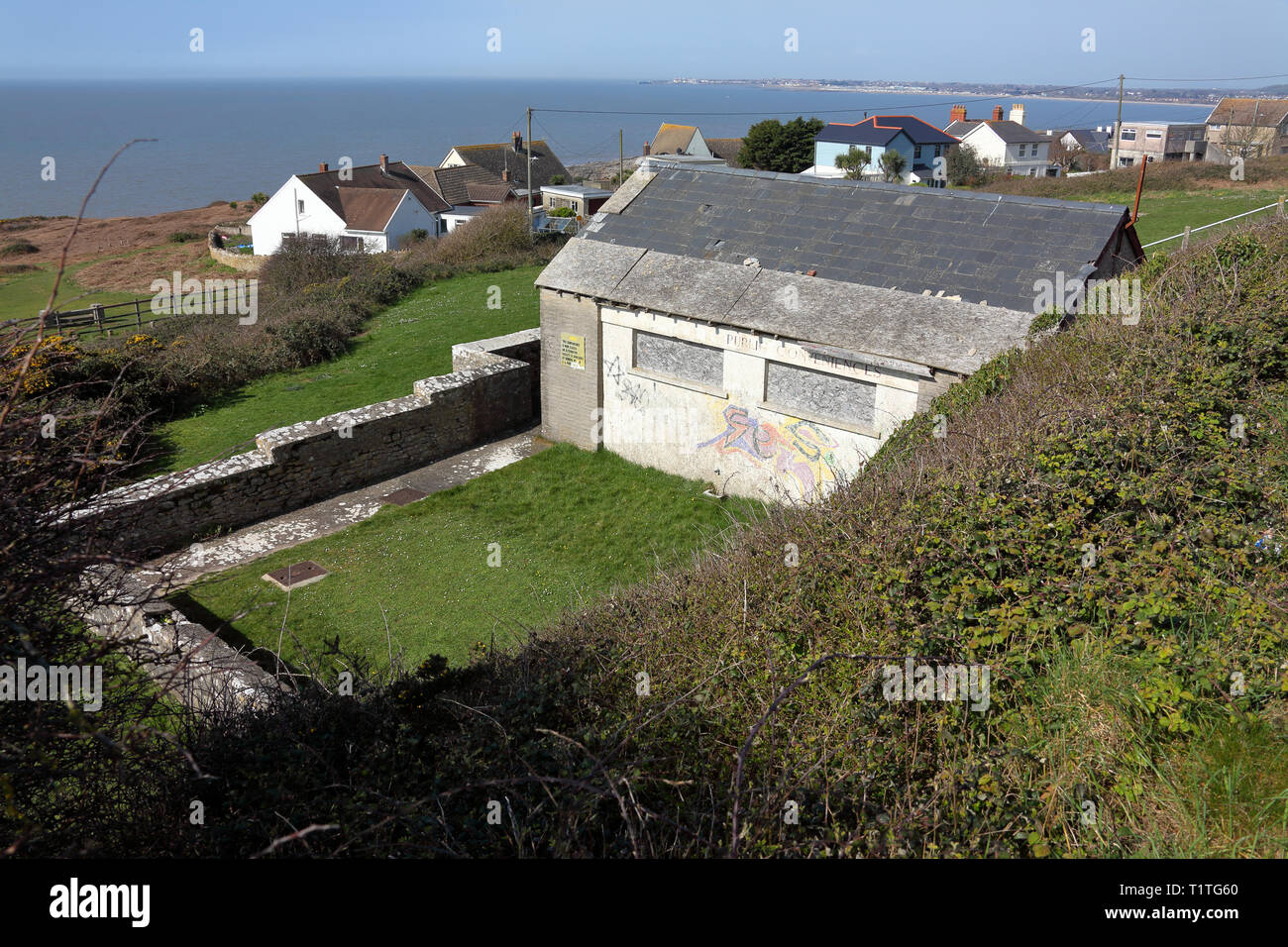 The old toilet block below the shops on the main road in Ogmore by sea, soon to be demolished to make way for the new village hall on this ground. - Stock Image