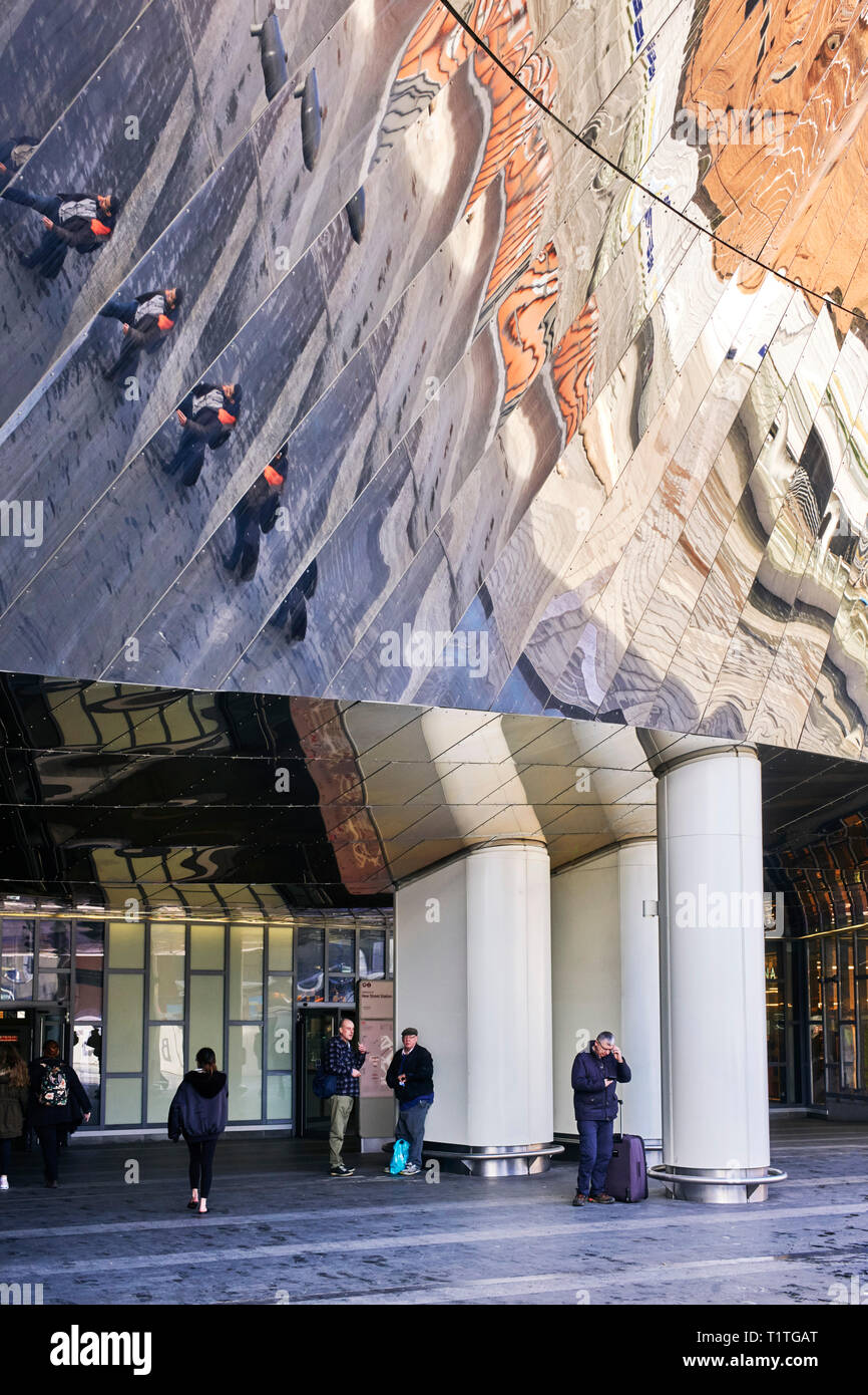 Reflections from the cladding on New Street Station Birmingham above the main entrance doors - Stock Image