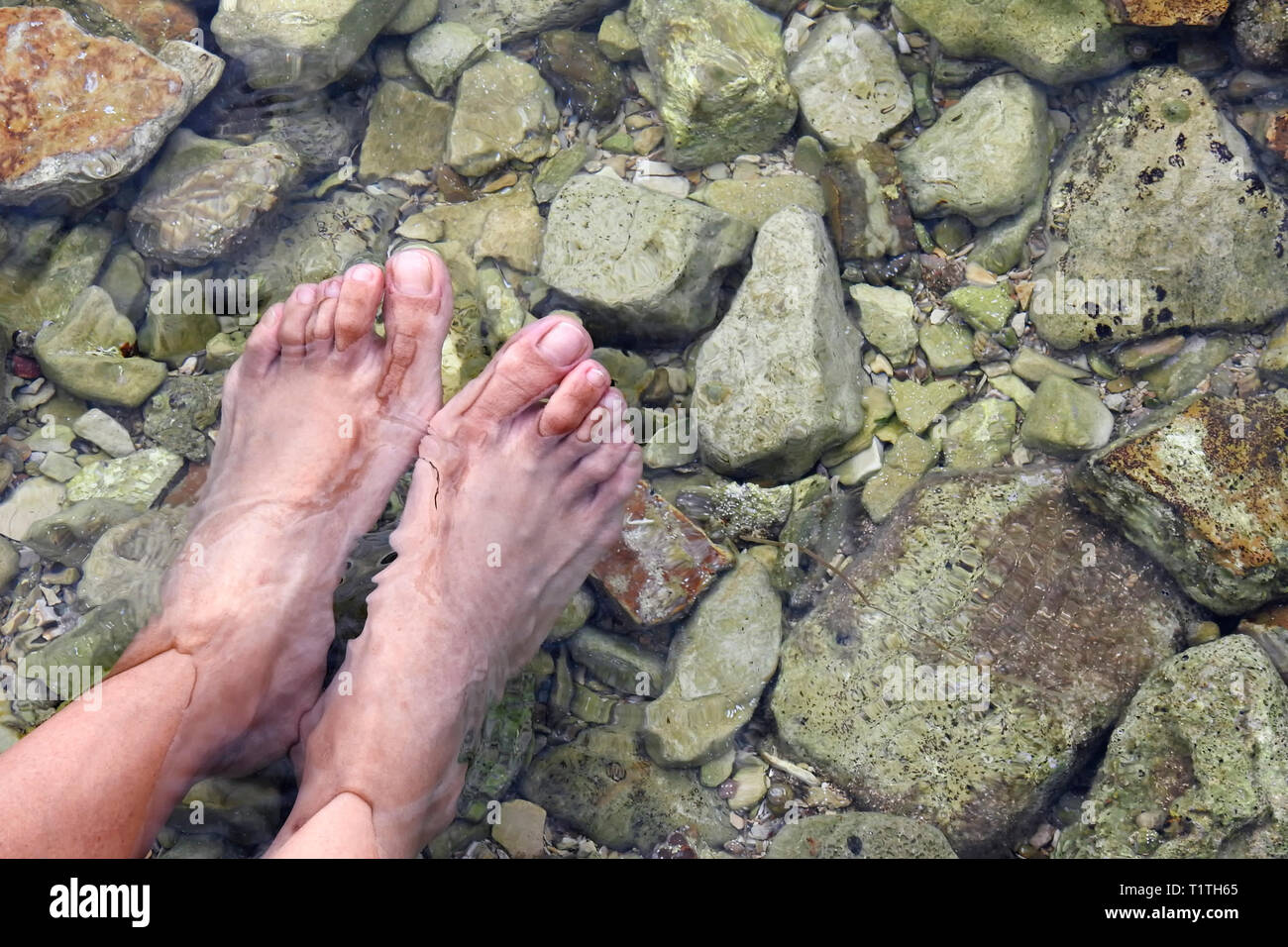 Close up of feet in the water - Stock Image