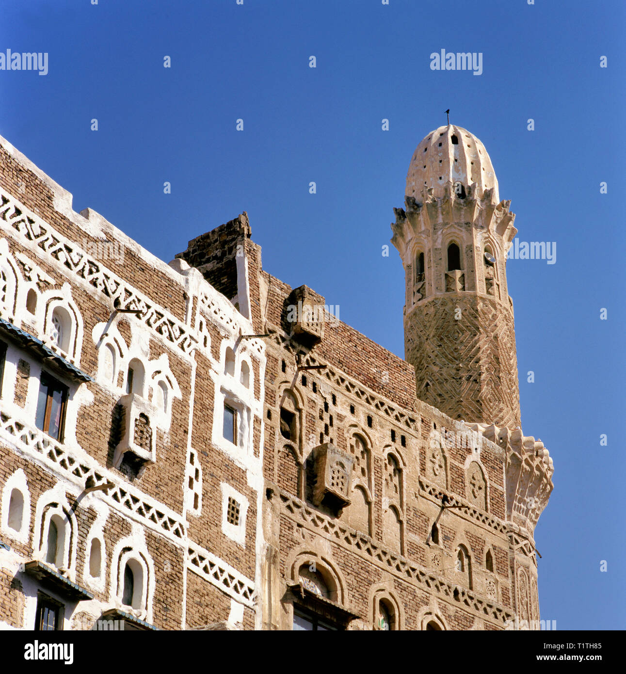 Traditional old houses and mosque in the Old Town, UNESCO World Heritage Site, Sanaa, Yemen, Middle East Stock Photo