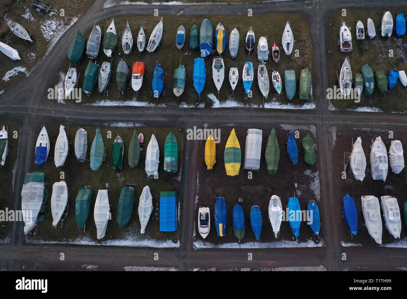 Aerial view of a marina, with boat laying site, by the lake Vättern a cold winter day. - Stock Image