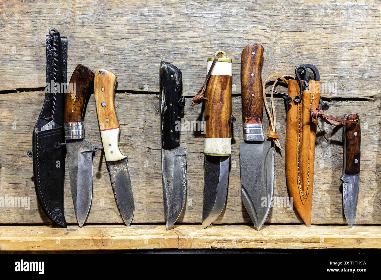 hand made knifes on the wooden table. - Stock Image