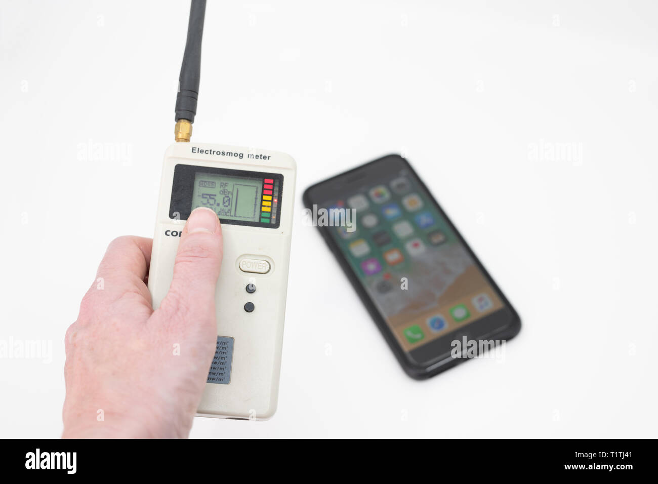 Testing the electromagnetic radiation given off by a smart phone - Stock Image