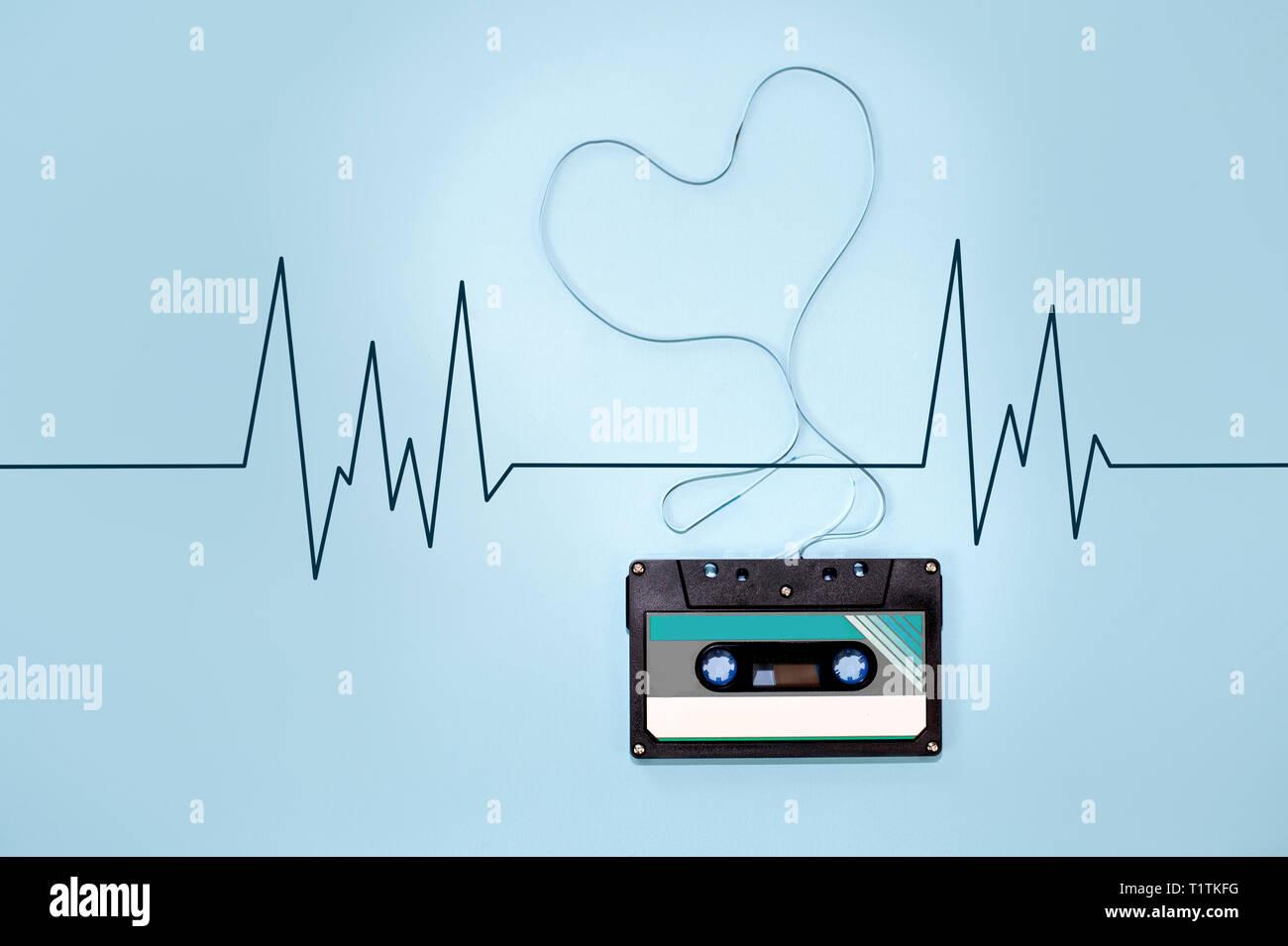 audio cassette tape tangled tape ribbon heart shape - Stock Image