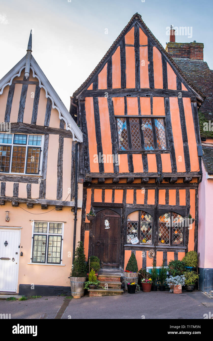 15th century Crooked House antiques shop and tearooms in quaint wonky crooked orange timbered building in High Street, Lavenham, Suffolk, England, UK. Stock Photo