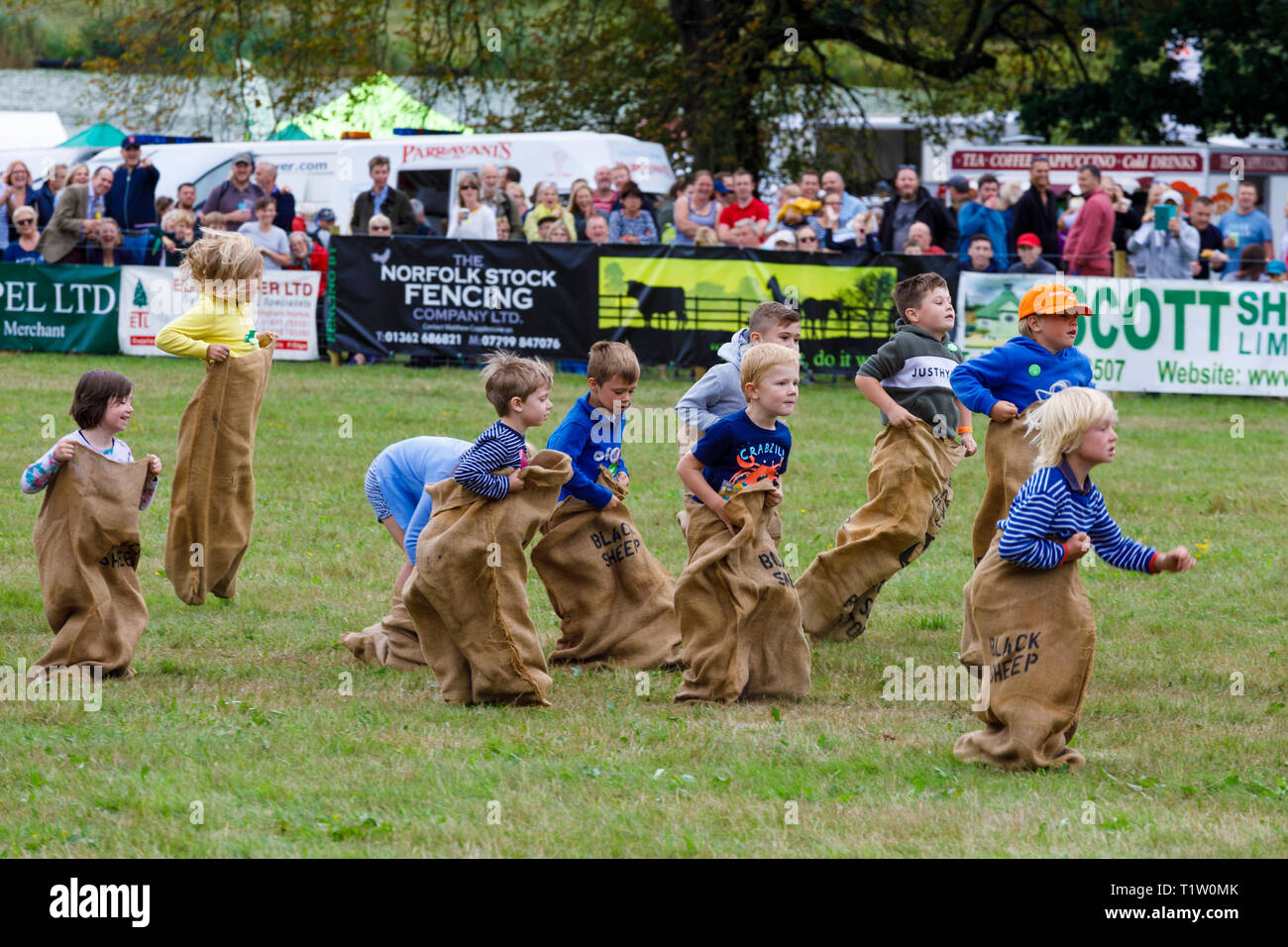 The childrens sack race in the main arena of the 2018 Aylsham Agricultural Show, Norfolk, UK. - Stock Image