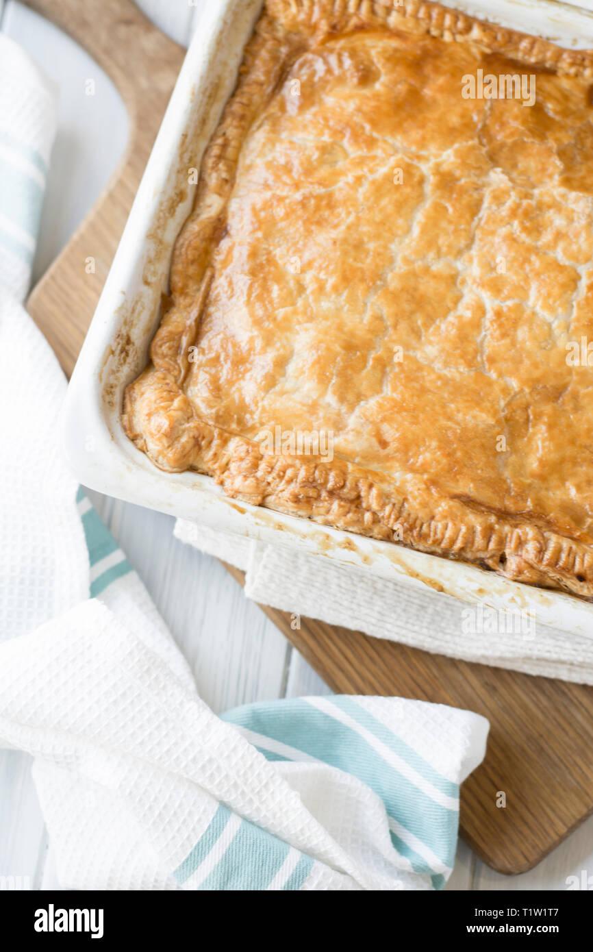 Midweek chicken pie recipe - Stock Image