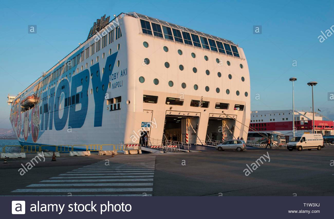 ITALY, SARDINIA, OLBIA,  Harbor of Olbia on the island of Sardinia at sunset with ferry Moby Aki preparing for departure - Stock Image