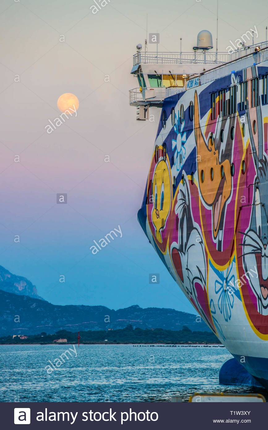 ITALY, SARDINIA, OLBIA, 2014-04-14: Bow of the Car-ferry Mobi Aki in the harbour of Olbia with full moon - Stock Image