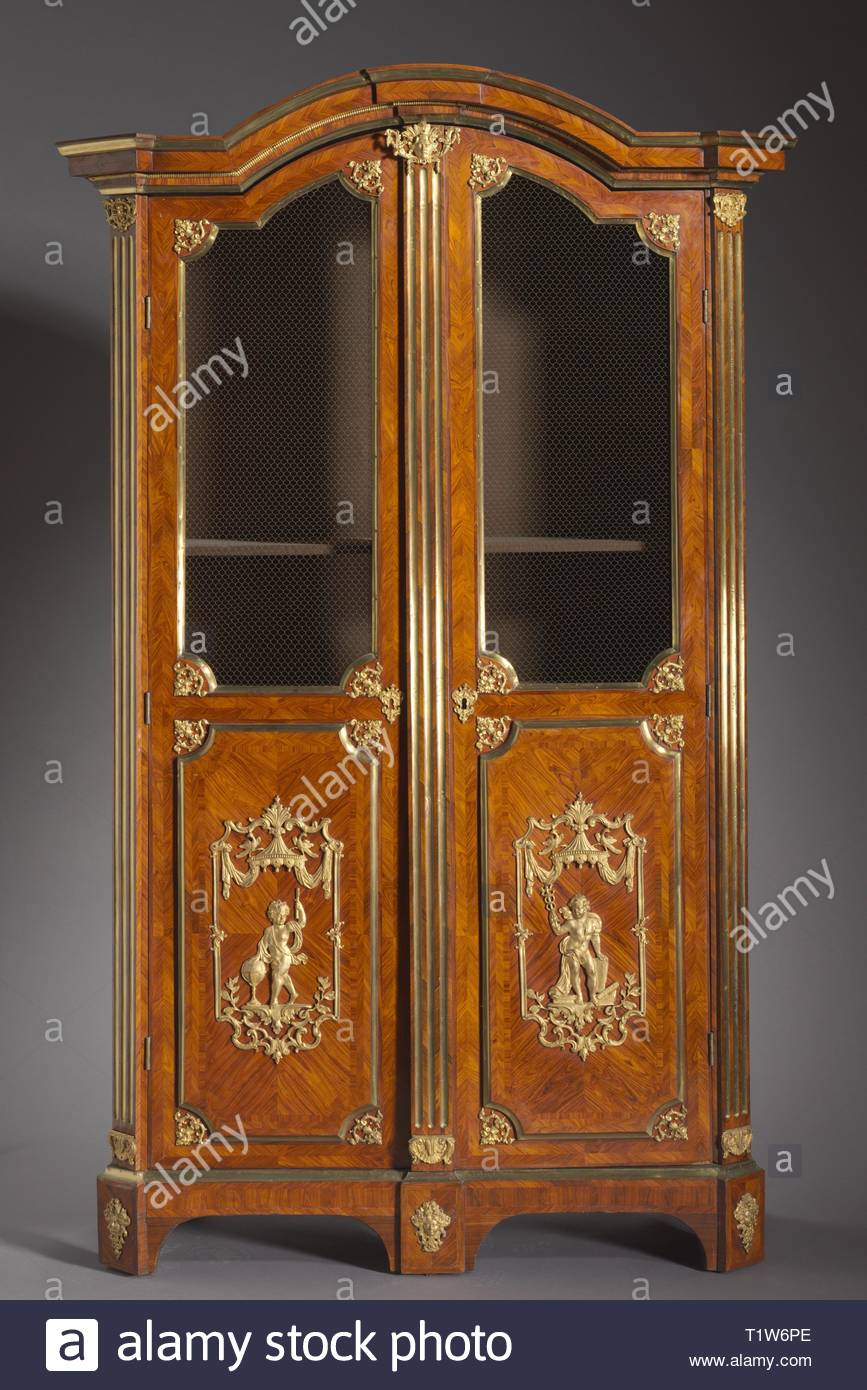 Pair of Bookcases (Bibliothèques), c. 1720. Attributed to Charles Cressent (French, 1685-1768). Kingwood and rosewood veneers, gilt metal mounts; overall: 247.6 x 132.1 x 57.2 cm (97 1/2 x 52 x 22 1/2 in.). - Stock Image