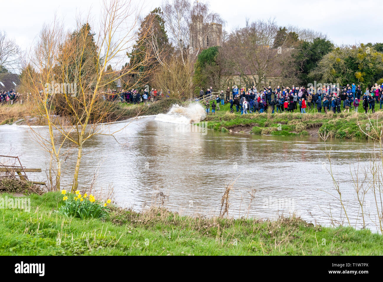 A 5 star Severn Bore on 22/3/2019 breaking against the bank and soaking onlookers at Minsterworth, Gloucestershire UK - Stock Image