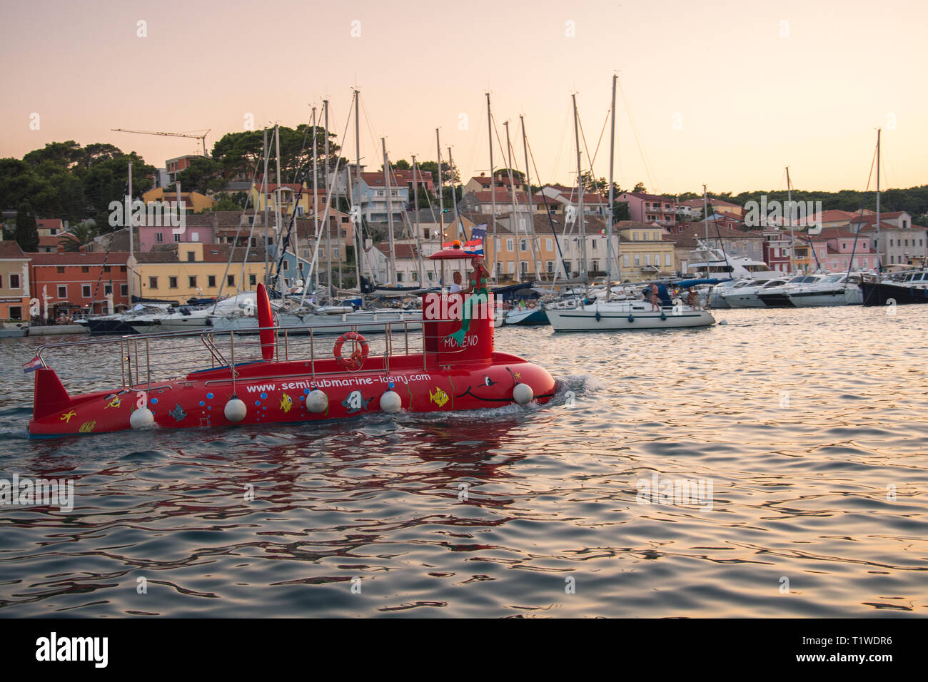 Semi-submarine leaving marina - Stock Image