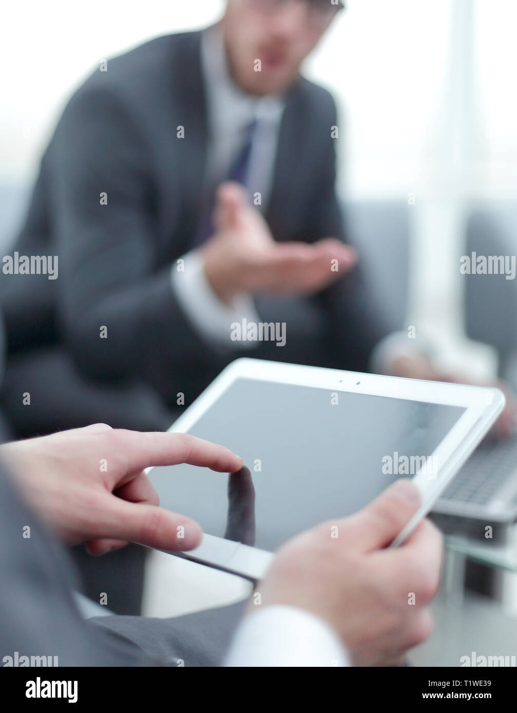 close up.businessman tapping the screen of the digital tablet - Stock Image
