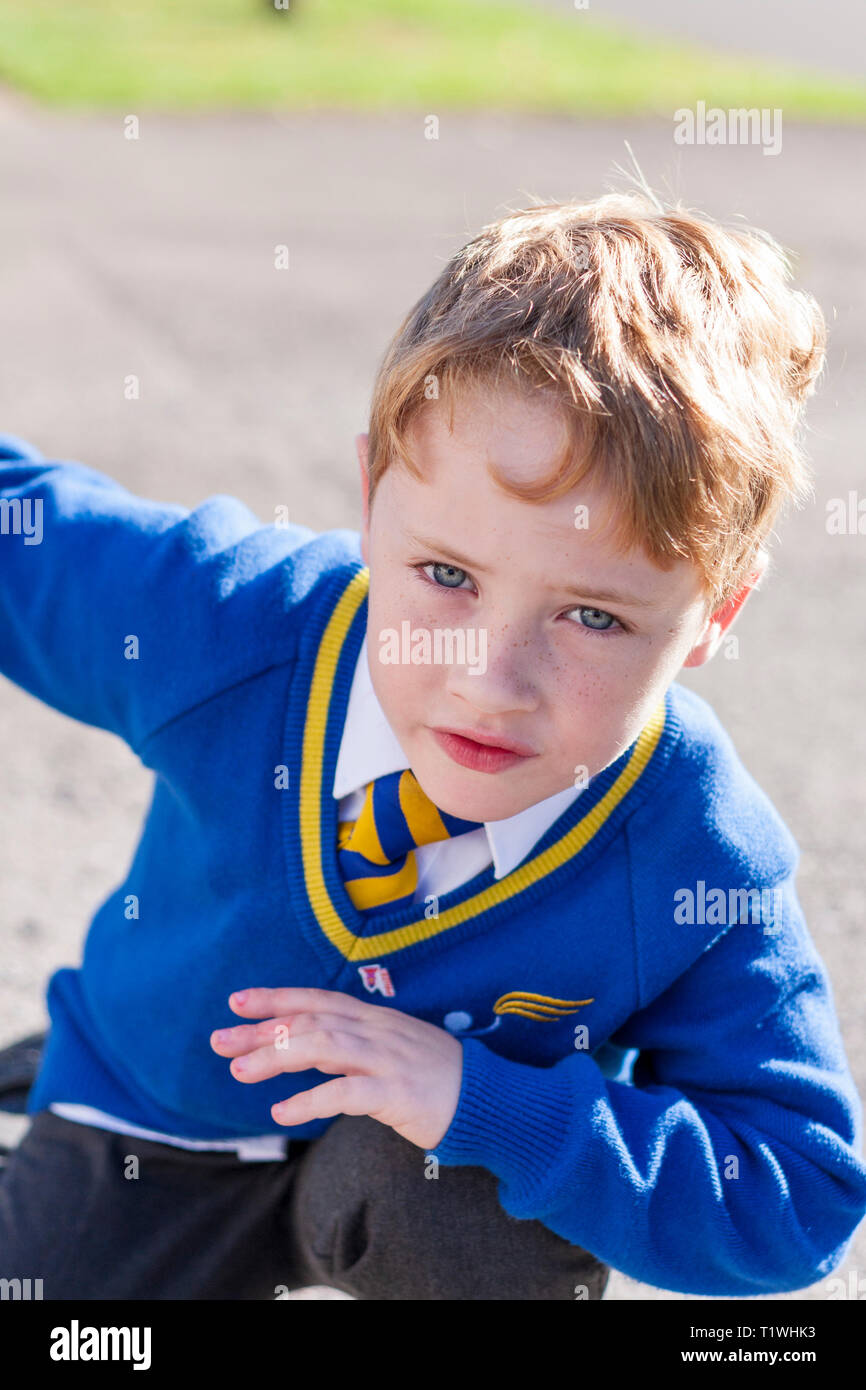 A young schoolboy doing the dab in front of the camera Stock