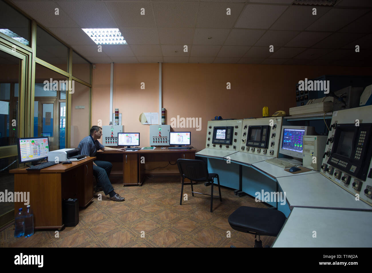 October 14, 2014. Kiev Ukraine. A middle-aged Caucasian man at work dispatcher plant control center, carefully analyzes the data on the monitors - Stock Image