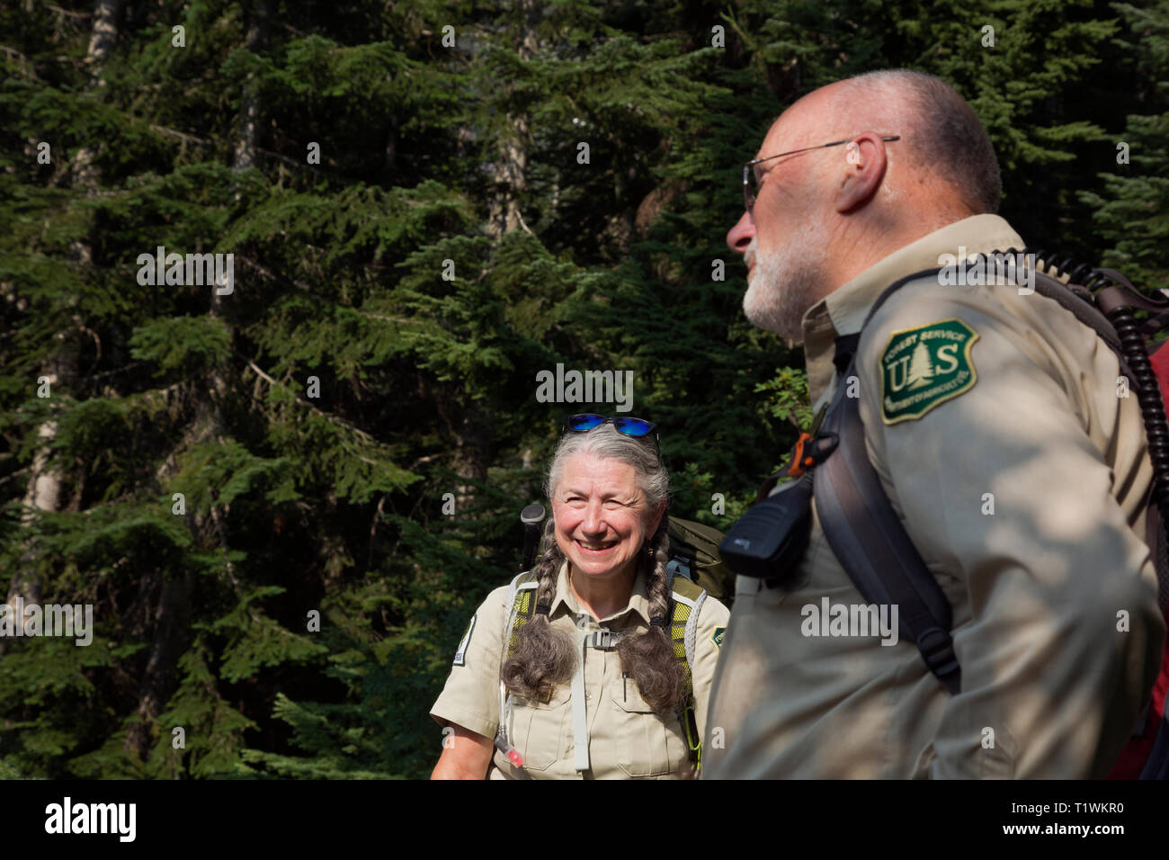 WASHINGTON - John Spring and Jane Ellen Seymour standing at the Snow Lakes Trailhead to to greet hikers and answer questions posed by hikers. - Stock Image