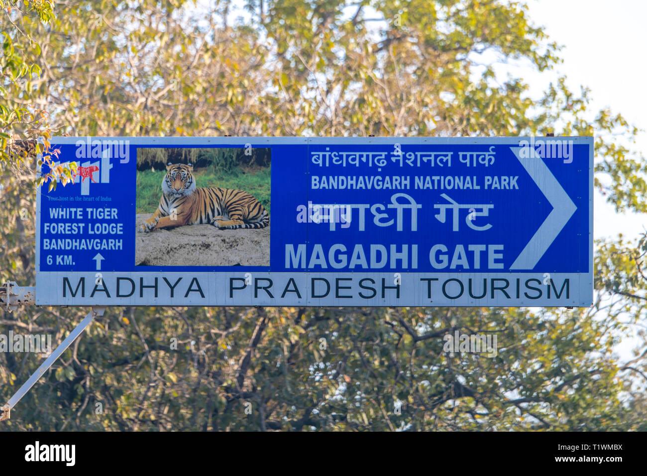 Sign indicates entrance via Magadhi Gate for Bandhavgarh National Park - Stock Image