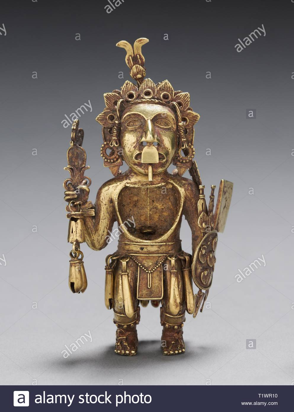 Figure of a Warrior, after 1325. Central Mexico, Tetzcoco?, Aztec, Post-Classic Period. Gold-silver-copper alloy (cast); overall: 11.2 x 6.1 cm (4 7/16 x 2 3/8 in.). - Stock Image