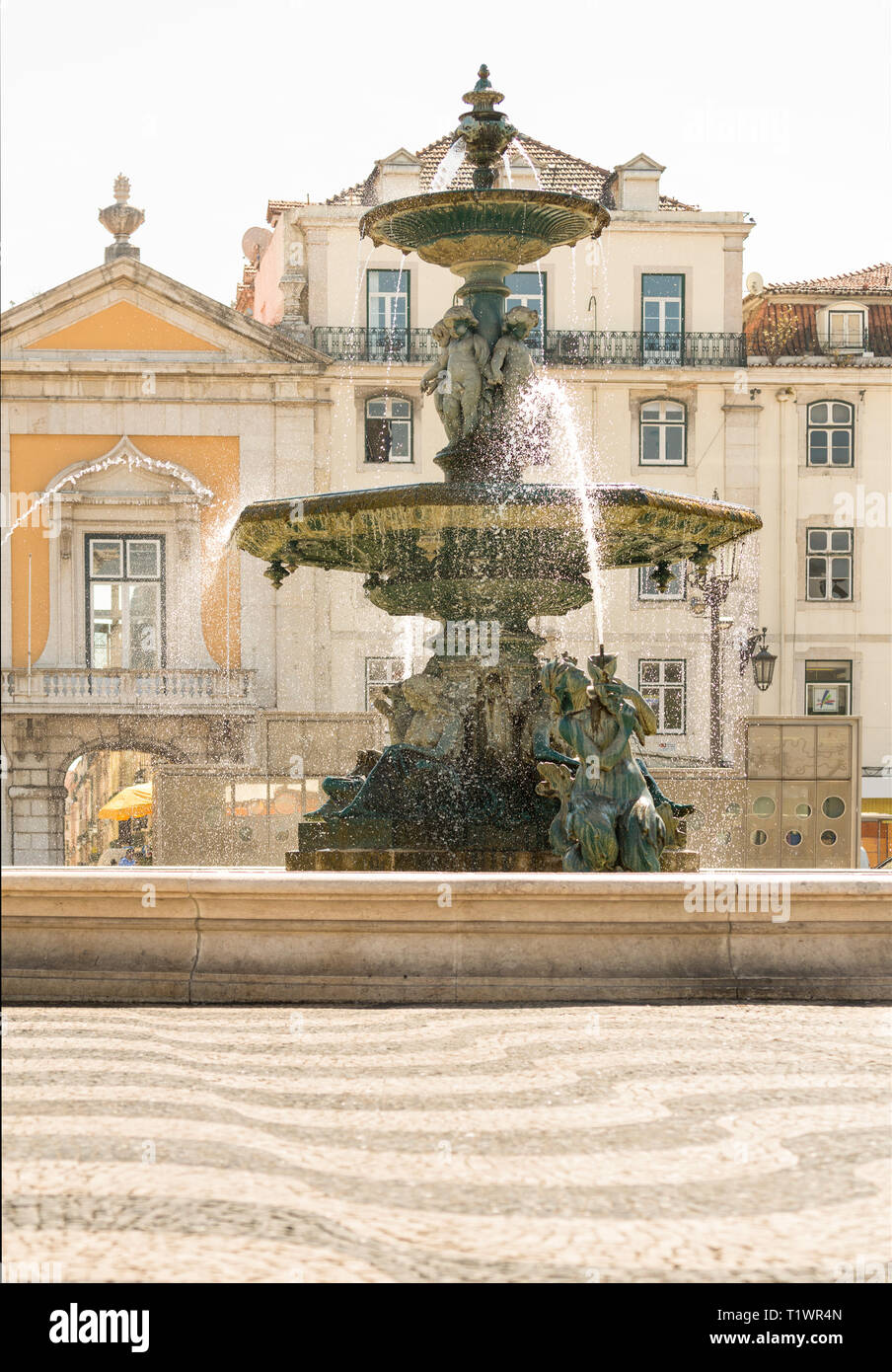 A beautiful, ornate, classical fountain on a public plaza in downtown Lisbon, Portugal - Stock Image