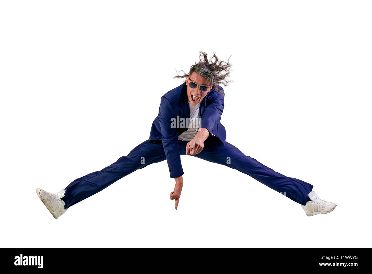 Confident Smart Looking Man Laughing and Jumping Up, Enjoying His Success - Wearing siut, isolated on white background - Real laugh, real jump... - Stock Image