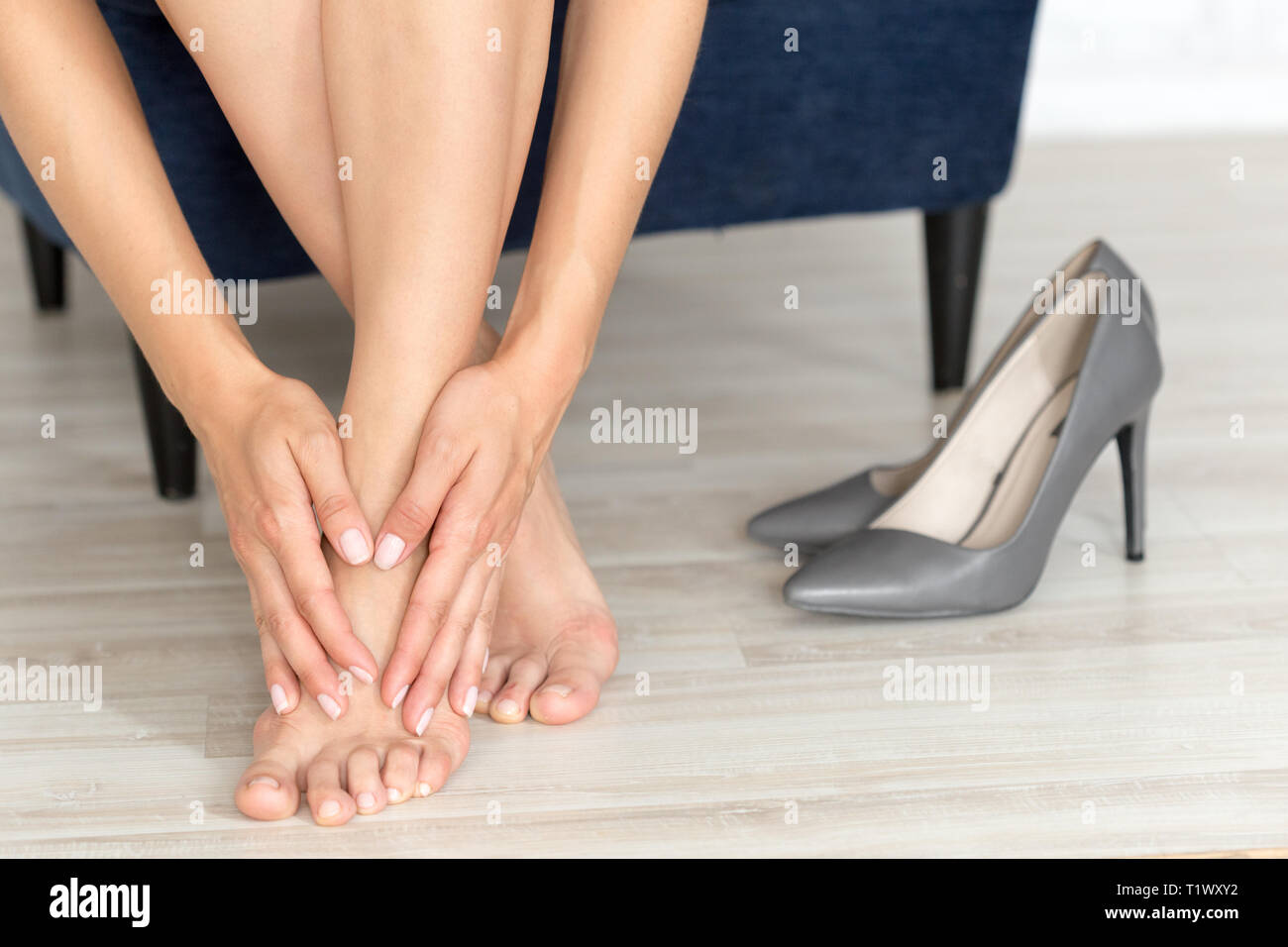 Tired and aching female feet after walking Stock Photo