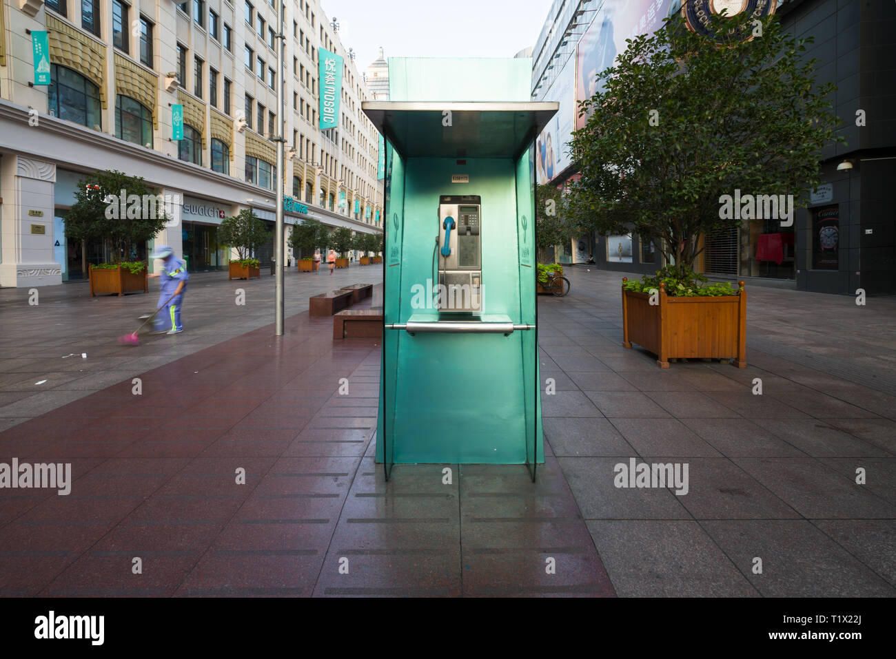 Shanghai, China - 08 12 2016: Green telephone booth also called phone booth, telephone kiosk, telephone call box, telephone box or public call box in - Stock Image