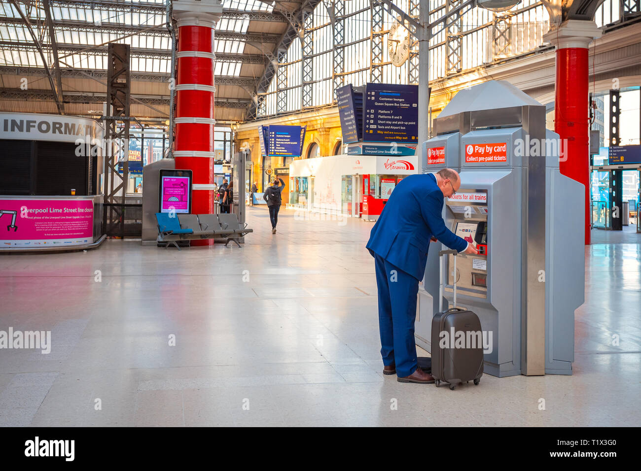 Liverpool, UK - May 18 2018: Unidentified people travel through trains at Liverpool Lime Street station at the Liverpool city centre - Stock Image