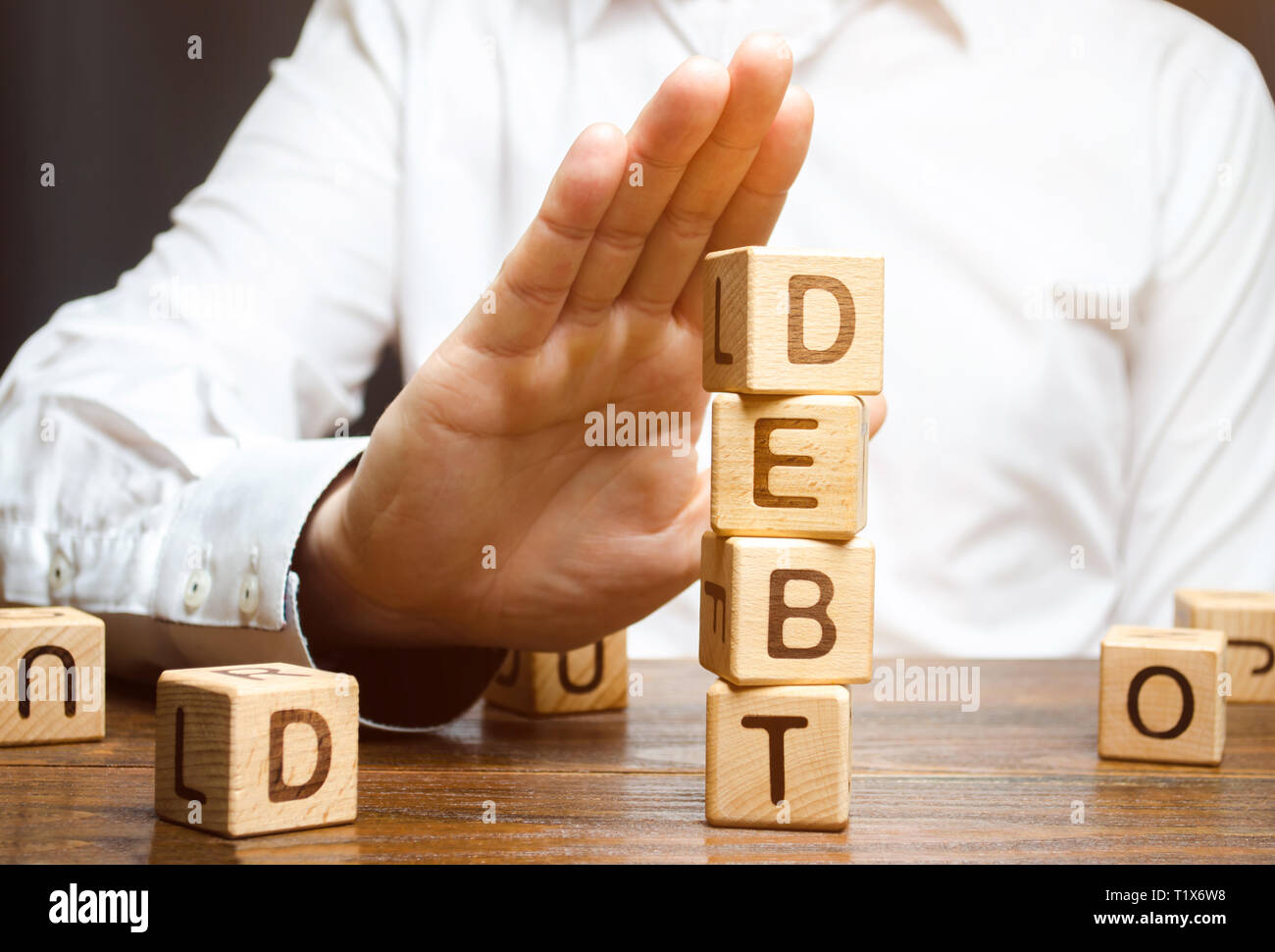 Businessman refuses to take a loan. Refusal of loans with high interest rates. Inability to pay the debt. Unprofitable terms of business lending by ba - Stock Image