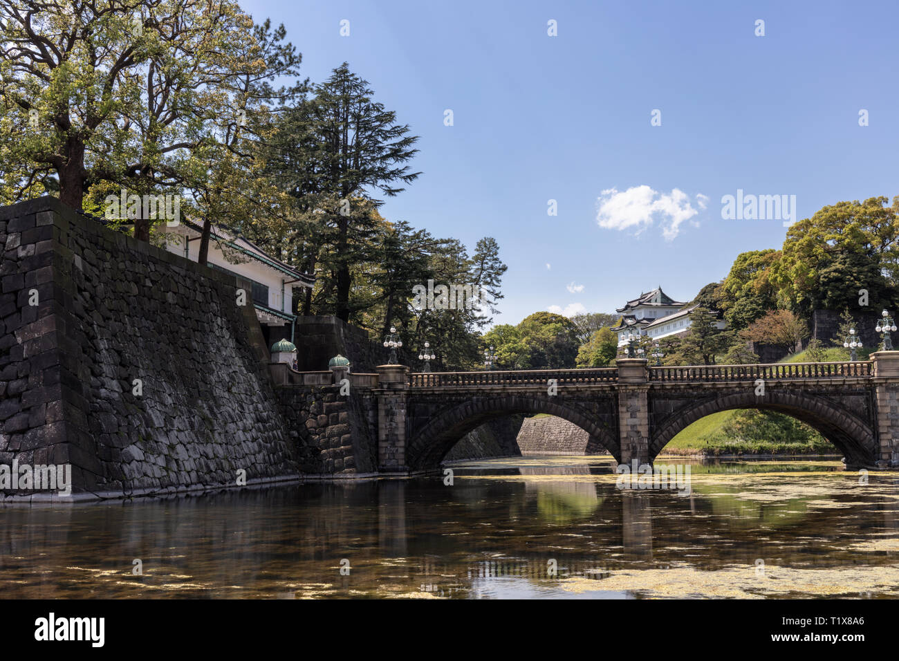 Tokyo, Japan - April 2017: Bridge over the moat at the Imperial Palace in Chiyoda - Stock Image