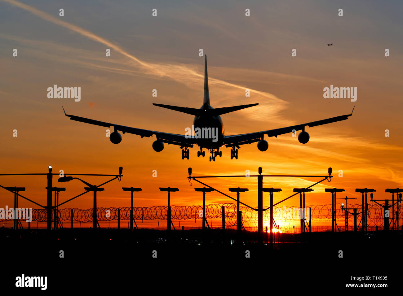 G-CIVE British Airways Boeing 747-400 airliner landing at Heathrow airport at sunset Stock Photo