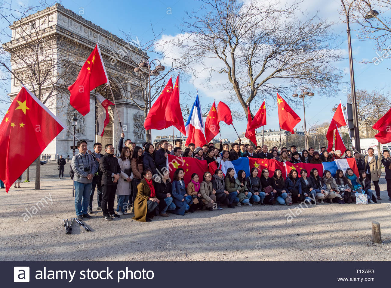 Chinese with chinese and french flags for Xi Jinping visite in france in March 2019 - Stock Image