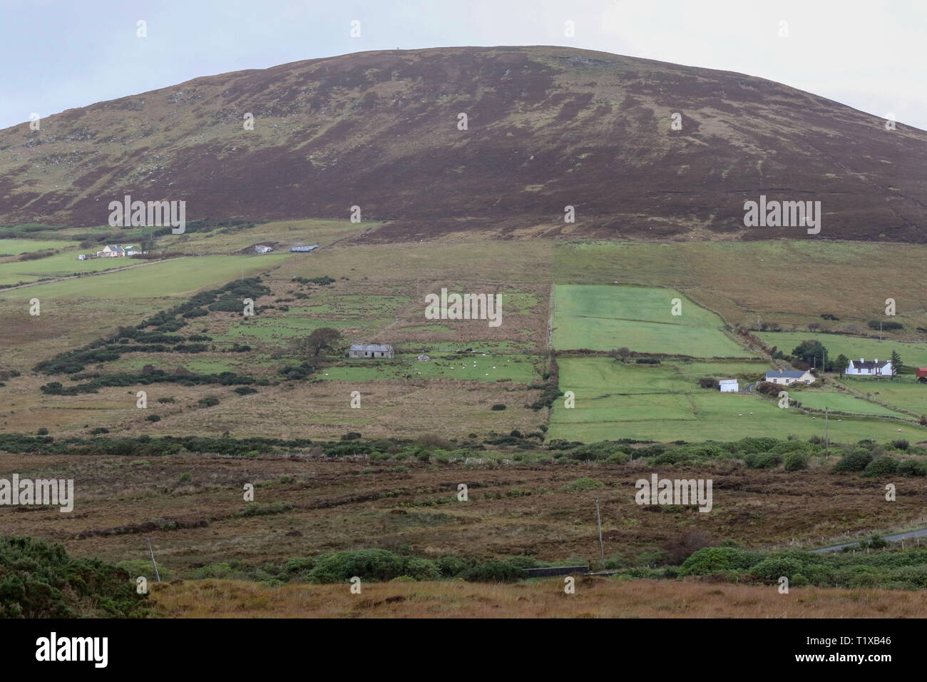 Hill fields cottages and bogland in rural Ireland near Ballycroy, County Mayo. - Stock Image