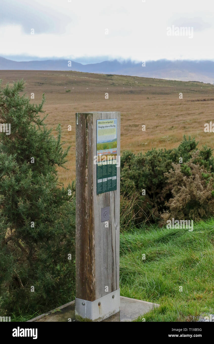 Irish bogland information post beside a looped walk at Ballycroy National Park, County Mayo, with the Nephin Beg Mountains in the background. - Stock Image