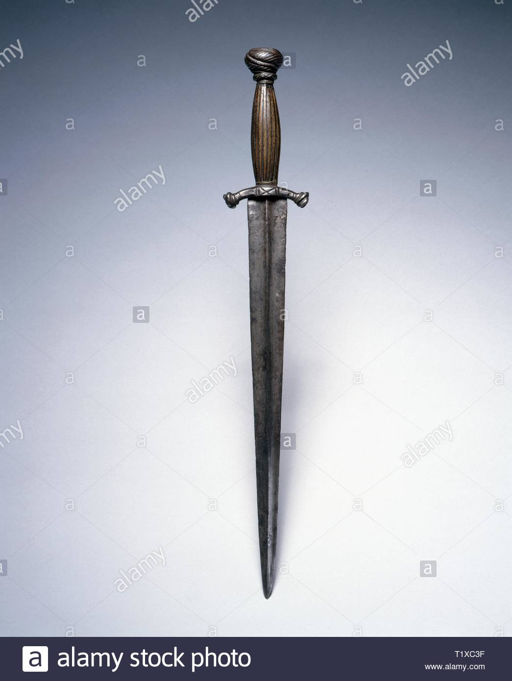 Dagger, mid 1500s. Germany, mid-16th century. Steel; elk horn grip; overall: 37.8 cm (14 7/8 in.); blade: 27.7 cm (10 7/8 in.); quillions: 6.5 cm (2 9/16 in.). - Stock Image