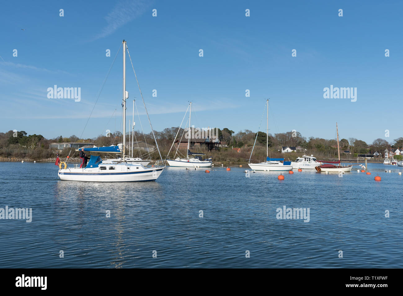 lymington harbour pier during the day - Stock Image