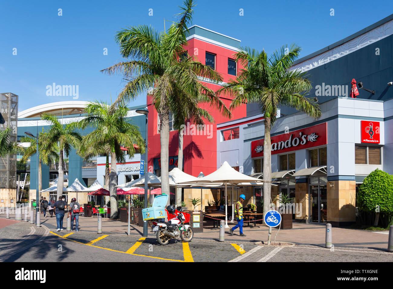Fast food restaurants at entrance to Gateway Theatre of Shopping, Palm Boulevard, Umhlanga Ridge, Umhlanga, KwaZulu-Natal, South Africa Stock Photo