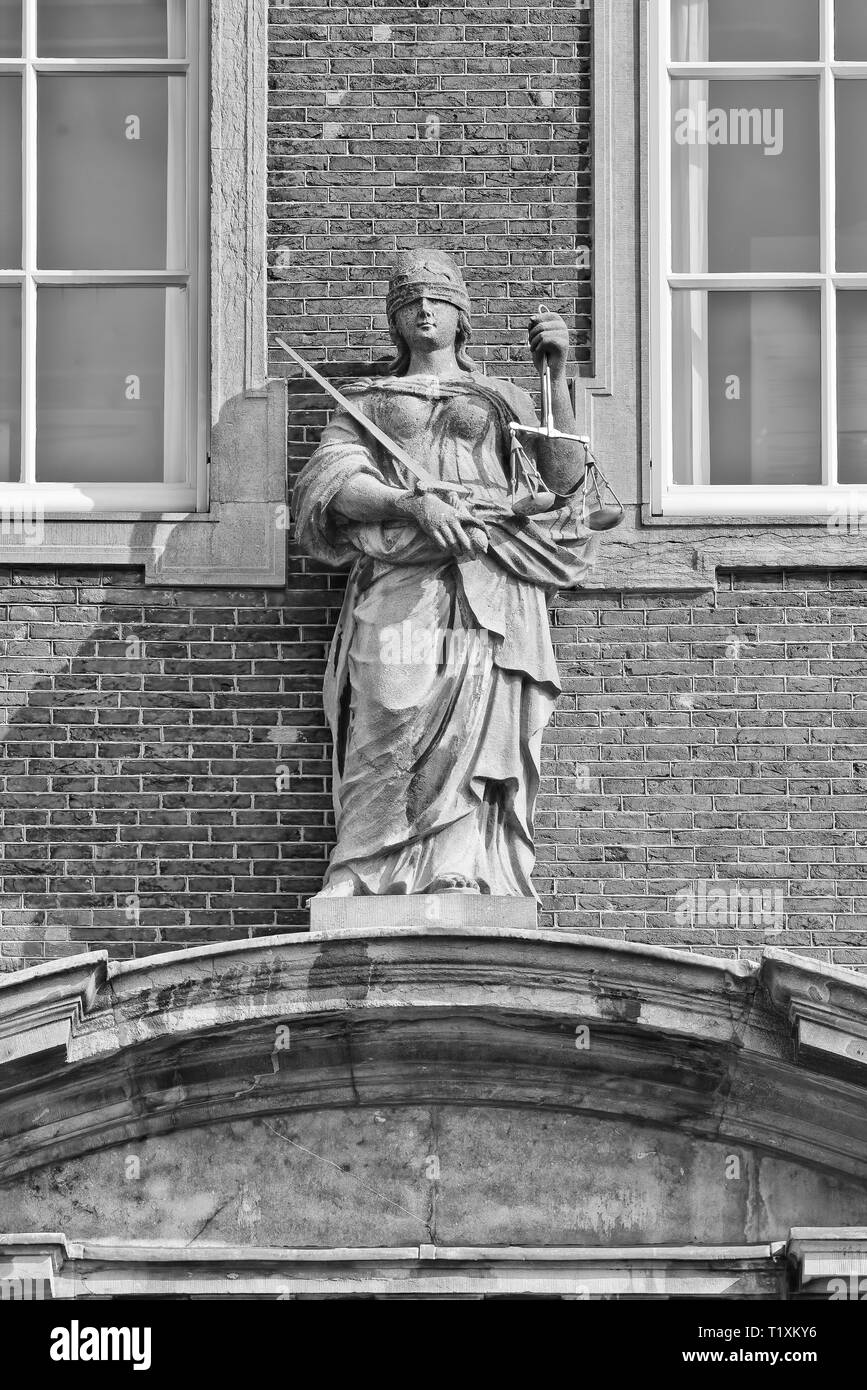 Lady Justice, goddess of Justice. Her blindfold stands for objectivity, balance in left hand weighing of evidence, sword in her right hand punishment. - Stock Image