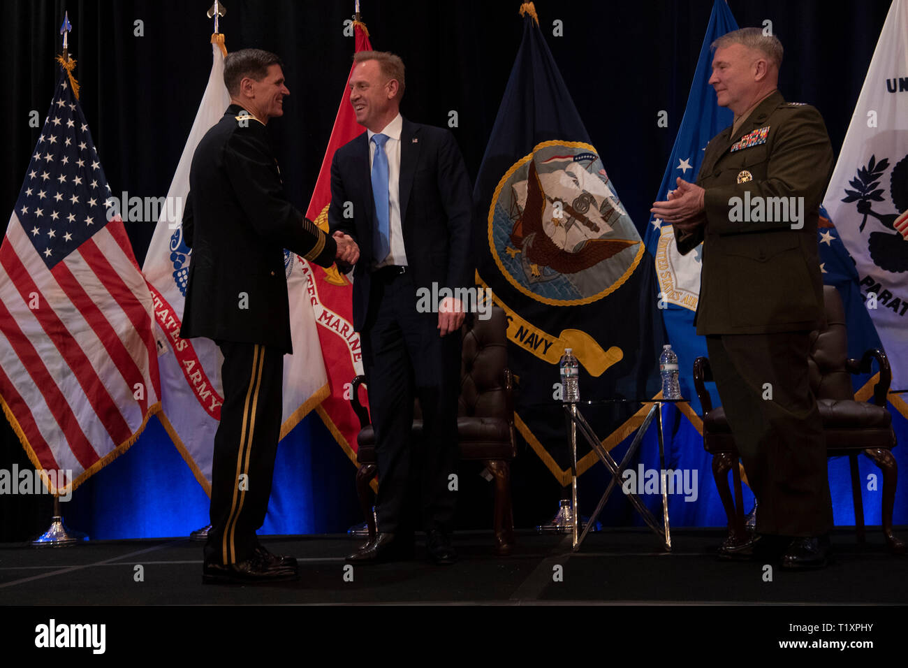 U.S. Acting Secretary of Defense Patrick M. Shanahan shakes hands with the outgoing commander of U.S. Central Command, U.S. Army Gen. Joseph L. Votel, at the Centcom change of command, Tampa, Florida, March 28, 2019. The new commander of U.S. Central Command, U.S. Marine Corps Gen. Kenneth F. McKenzie Jr., is to the right. (DoD photo by Lisa Ferdinando) Stock Photo